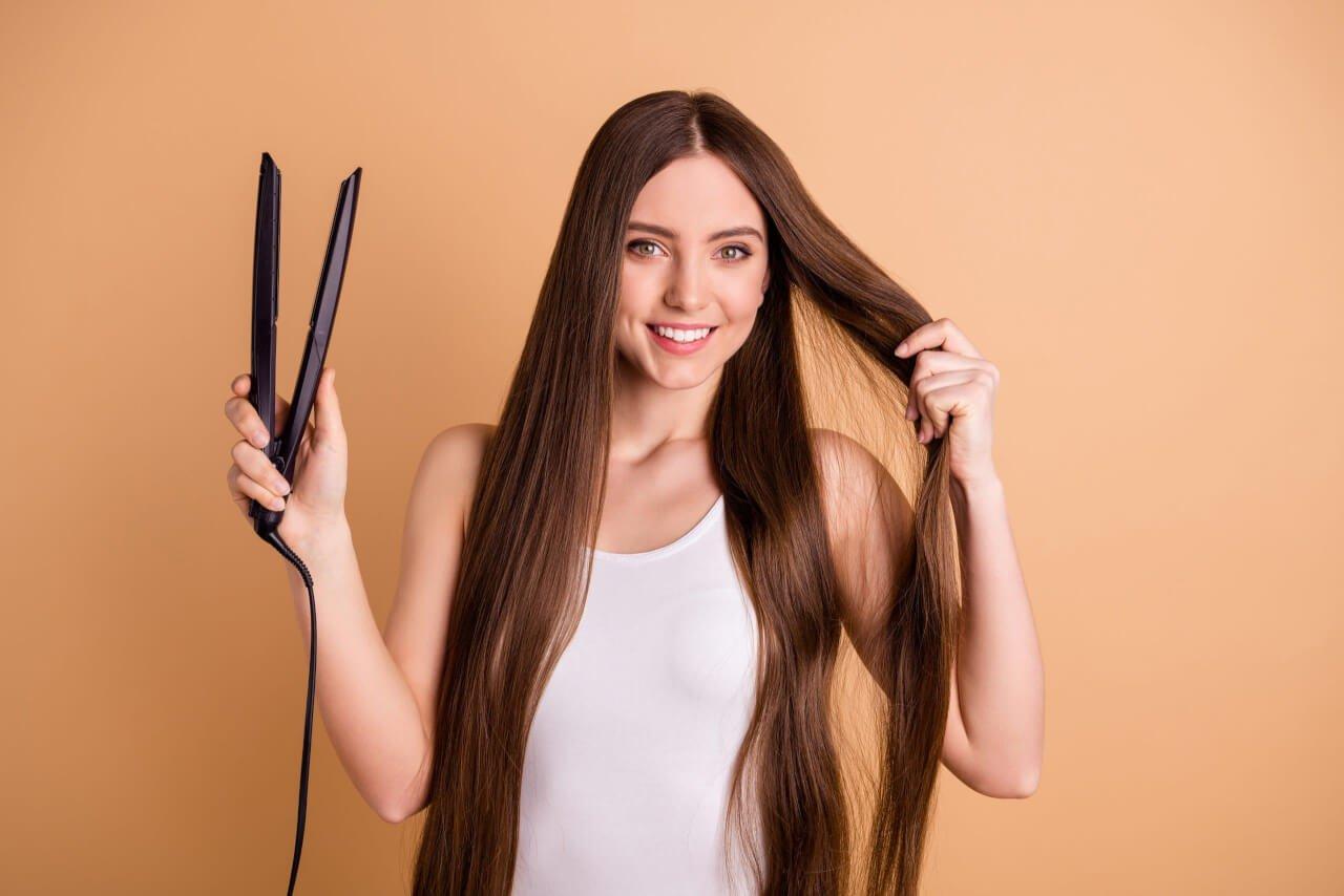 Con quale frequenza va usata la piastra per capelli per evitare problemi